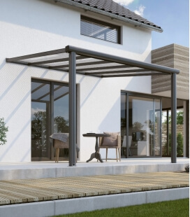 Compact aluminum pergola edition colris alu 7016 and integrated gutter with polycarbonate roof