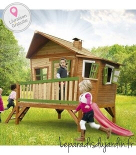 Garden hut on stilts child Emma in tropical wood