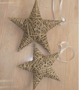 Christmas star to hang in wickerwork vegetable fiber on a metal structure with ribbon and ring for hanging.