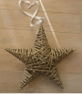 christmas star to hang vegetable fiber basketry on metal structure with ribbon and ring for hanging.