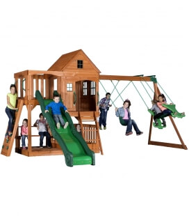Huge Child Playground Full Hill crest untreated exotic wood by backyard garden