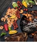 Brasero barbecue Nero en action nourriture à profusion par Remundi en acier de premier choix